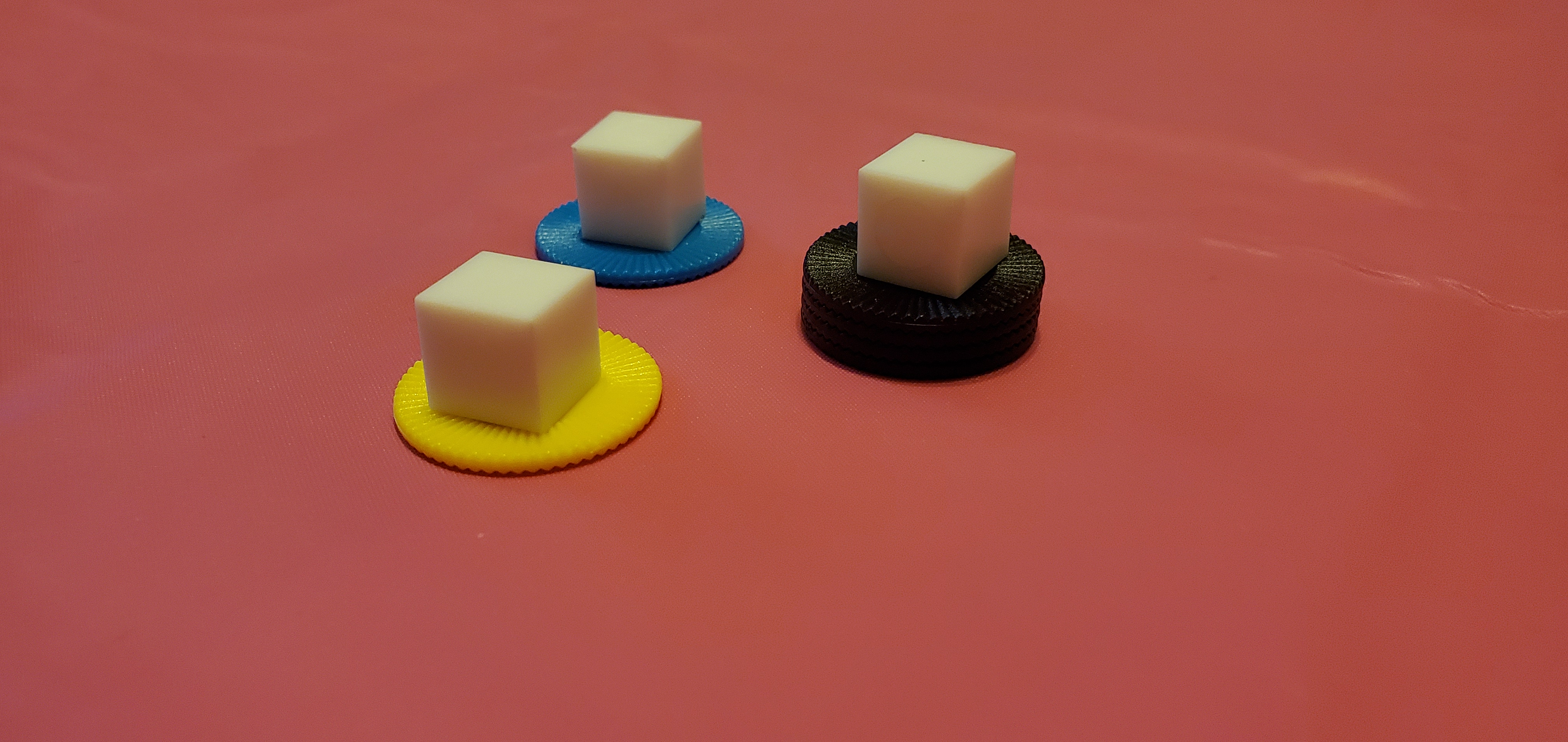 Acrylic gaming cubes on stacks of mini poker chips.