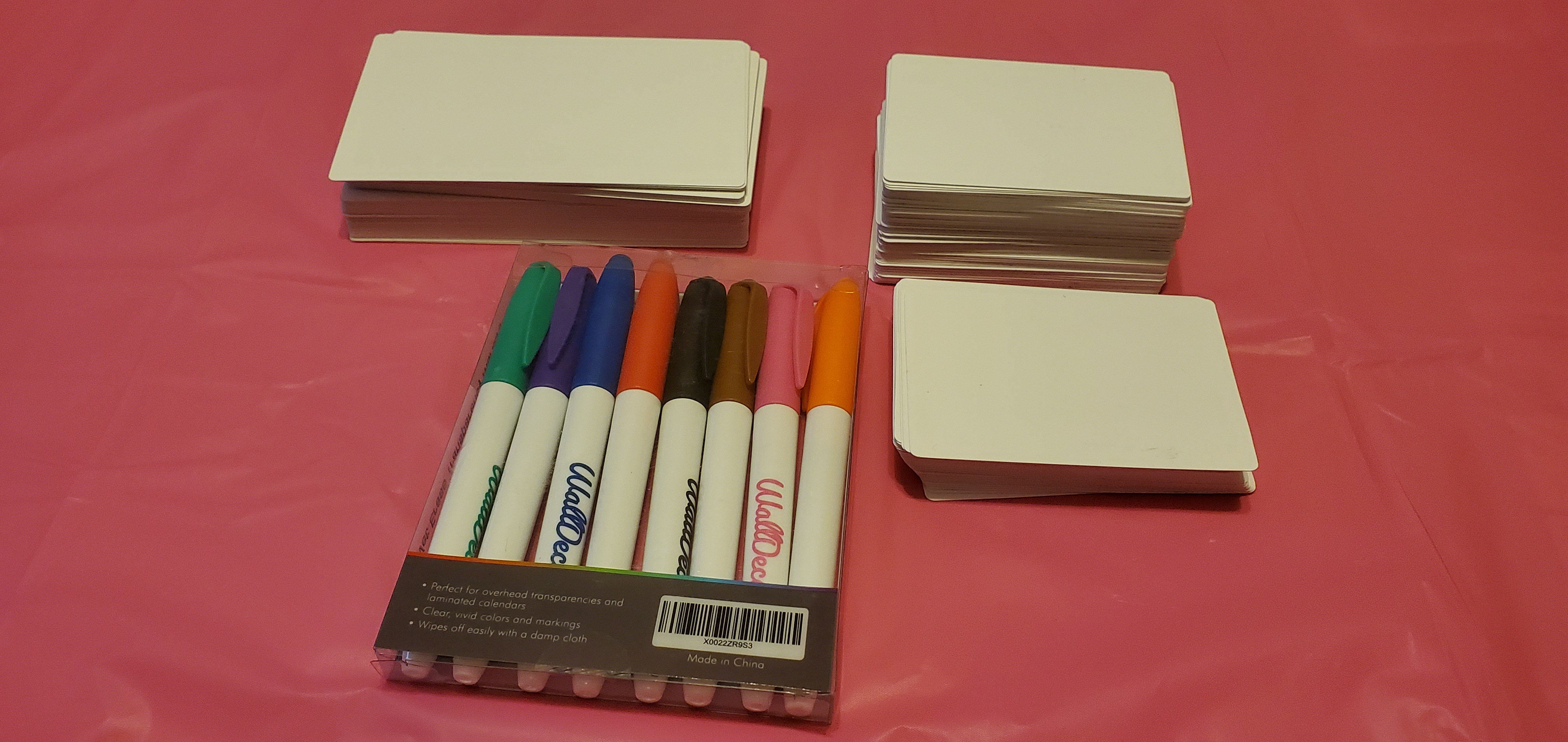 Dry erase index and poker cards and wet erase markers.